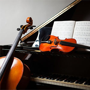Classical music concert featuring piano, violin, and cello.