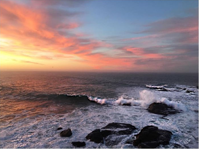 Sunset and waves at Fort Ross. Photo by Ed Storck.